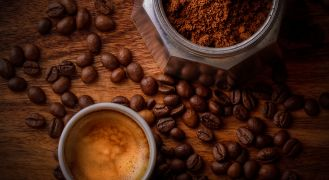 Coffee Terminology - cup and maker with beans
