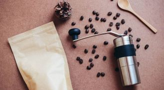 Flat lay of porlex mini coffee grinder and beans