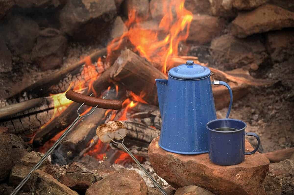 Making coffee camping - campfire and pot