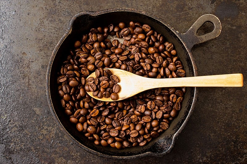 Coffee beans in heavy fry pan - a stove coffee roaster