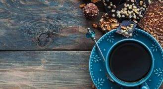 blue coffee cup on table