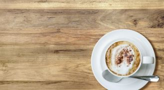 Flat lay of cappuccino on table