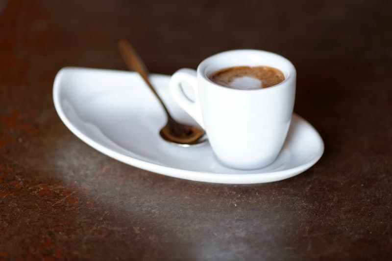close up of coffee macchiato on table