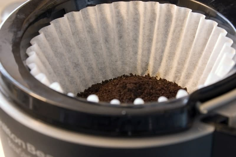Paper filter and coffee grounds in the best pour over coffee maker automatic