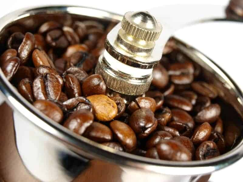 Close up of coffee beans in manual coffee grinder