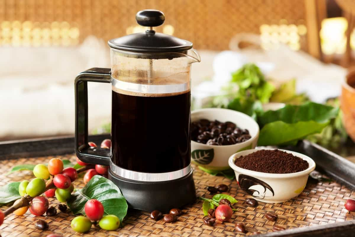 French press coffee maker on table - best coffee grinder for french press coffee