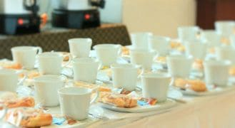 Best coffee urns - catering event with white coffee cups