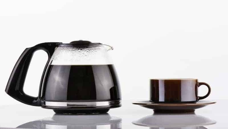 Coffee carafe with coffee cup