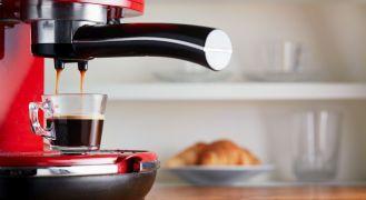Red espresso machine on bench