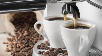 affordable cappuccino machine pouring coffee into two cups
