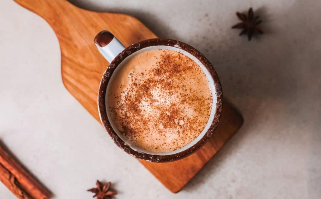 Homemade PSL coffee on table