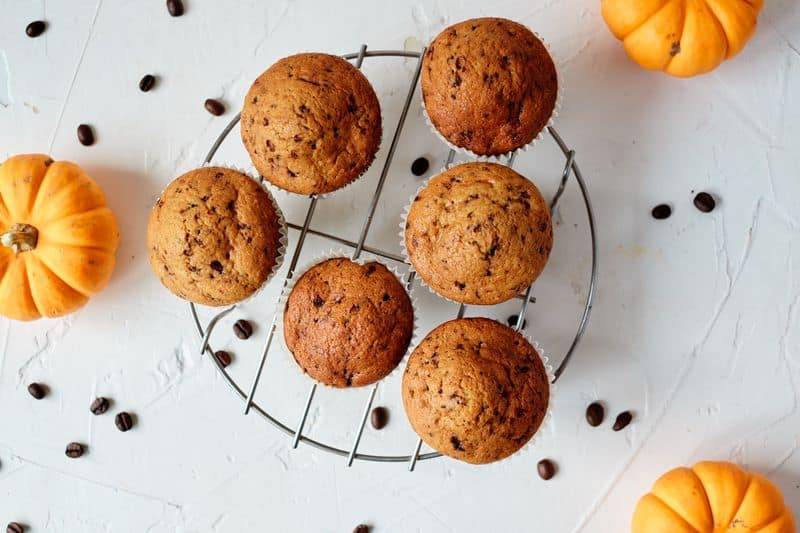 flat lay of yogurt pumpkin muffins on bench