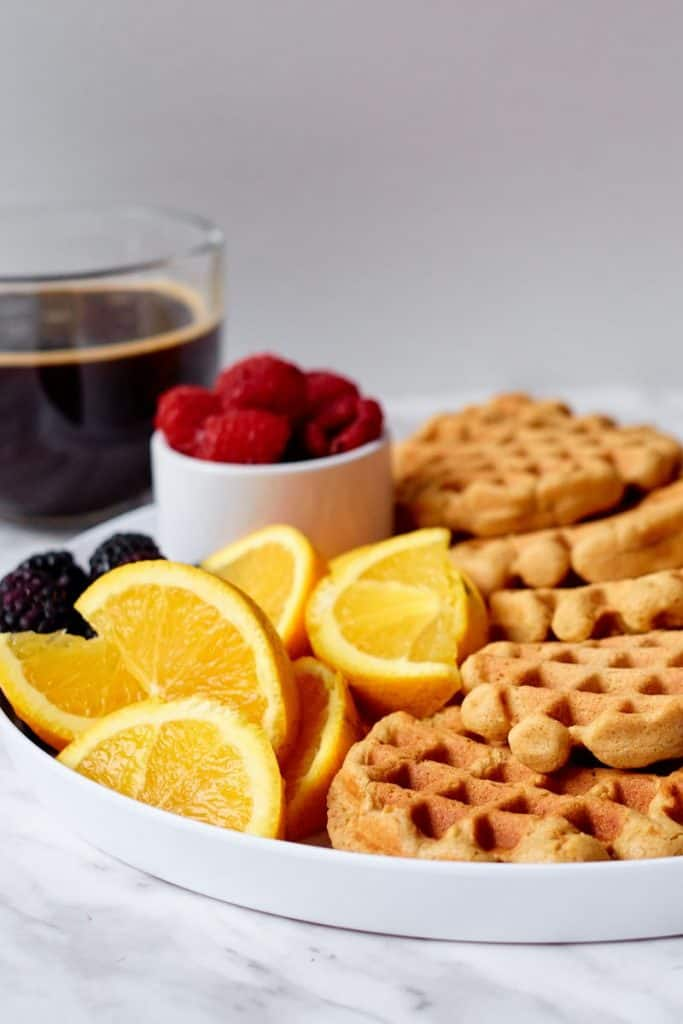 waffles with aunt jemima pancake mix on plate with fruit and cup of coffee