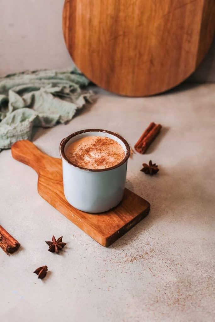 pumpkin spiced latte in blue mug