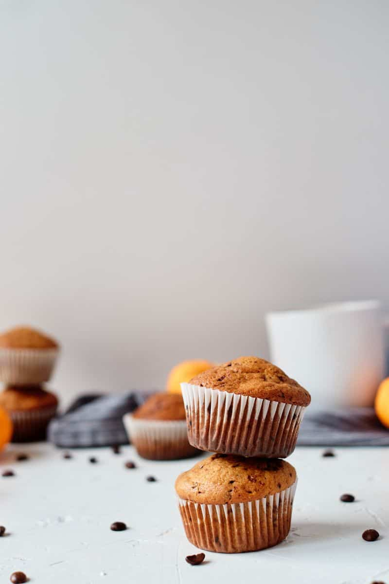 2 pumpkin muffins with greek yogurt stacked on top of each other