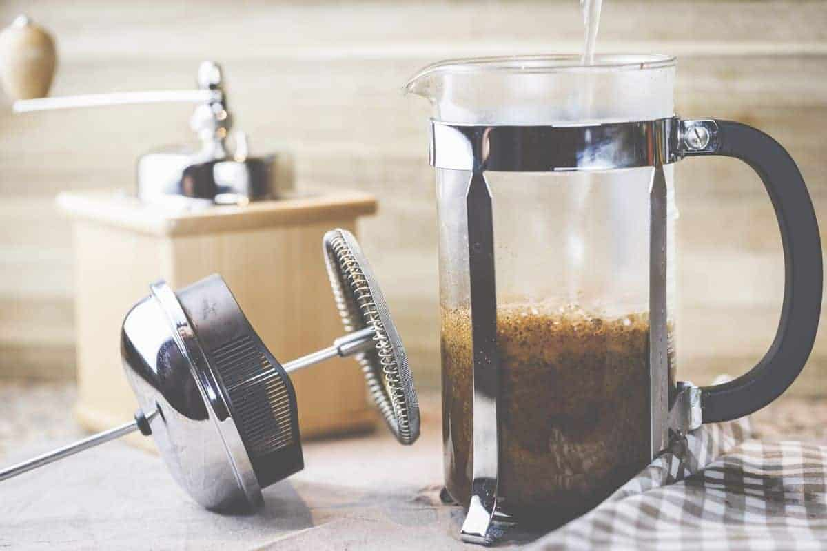 coffee press carafe and filter on table