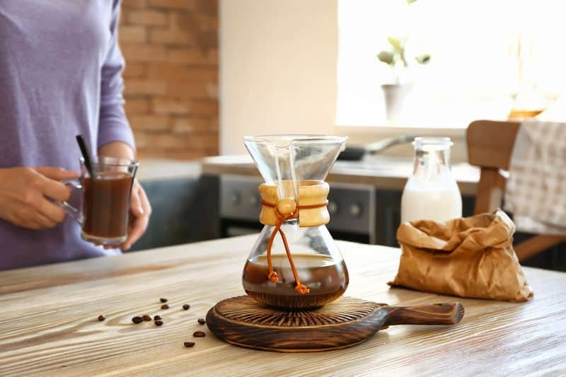 Glass chemex coffee maker on table