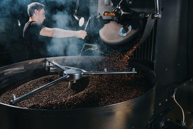Large coffee roaster roasting fresh coffee beans