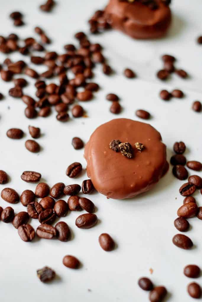chocolate covered fudge balls with coffee beans.