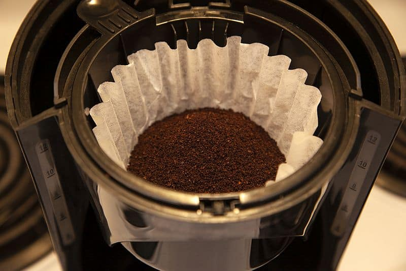 Filter coffee maker paper filter filled with coarsely ground coffee beans