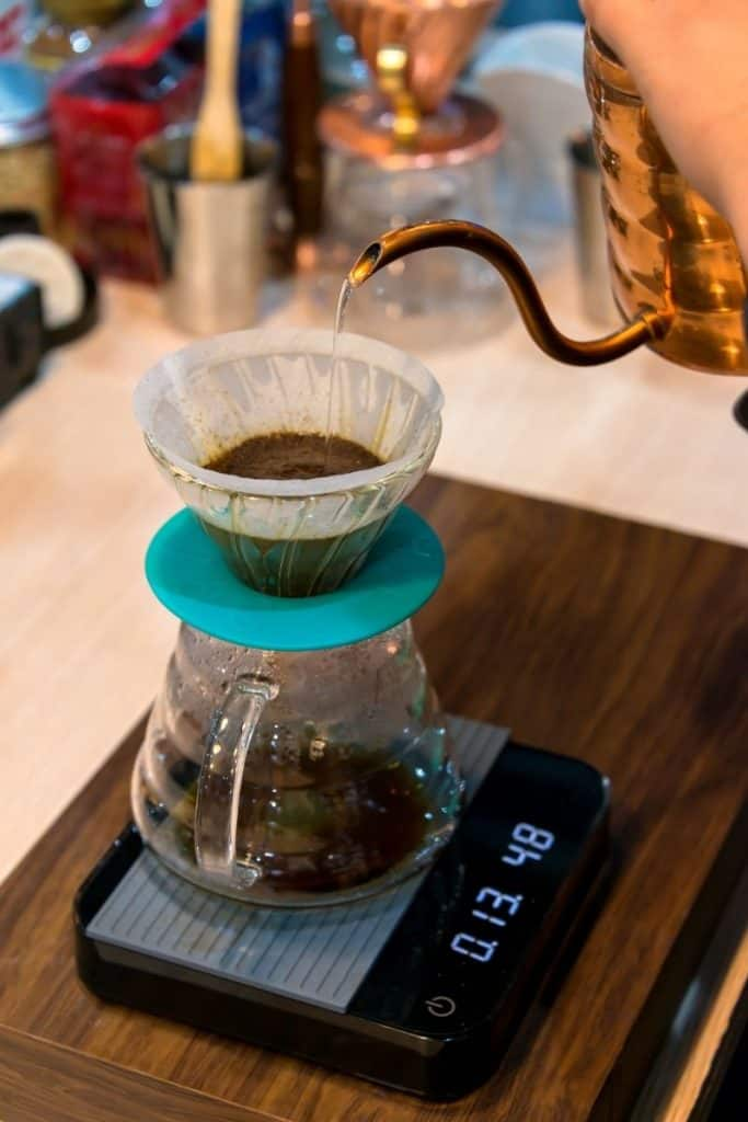 Manual pour over filter on top of coffee brewing scale with timer.