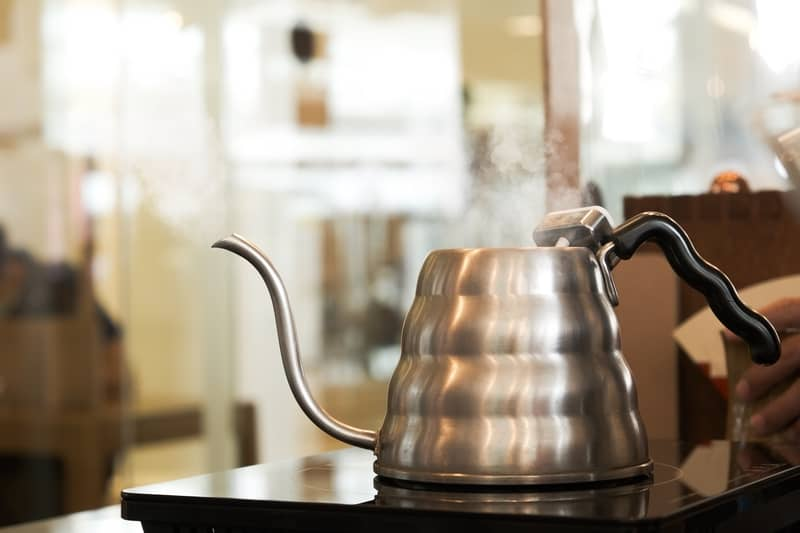 Preparing hot water in pour over kettle for a coffee drip