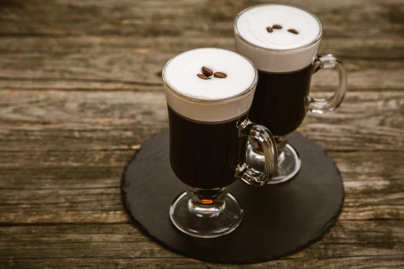 Hot Irish coffee with whiskey and cream