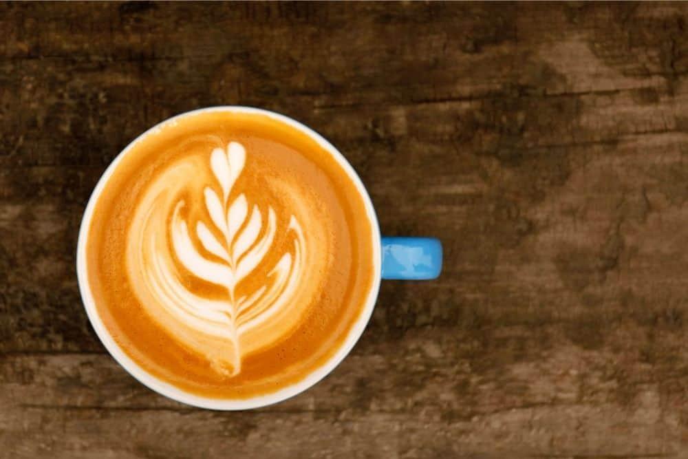 latte cafe drink in blue cup