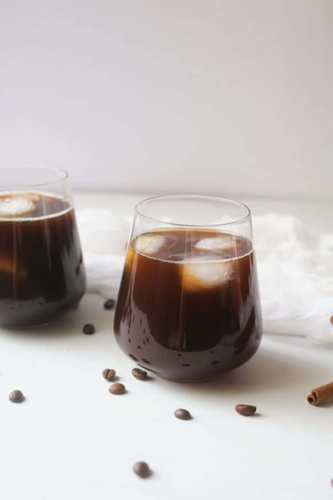 Glass of cold brew coffee on table.