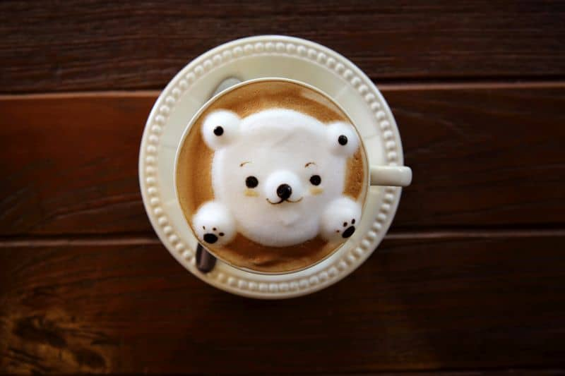 Latte coffee with bear on top