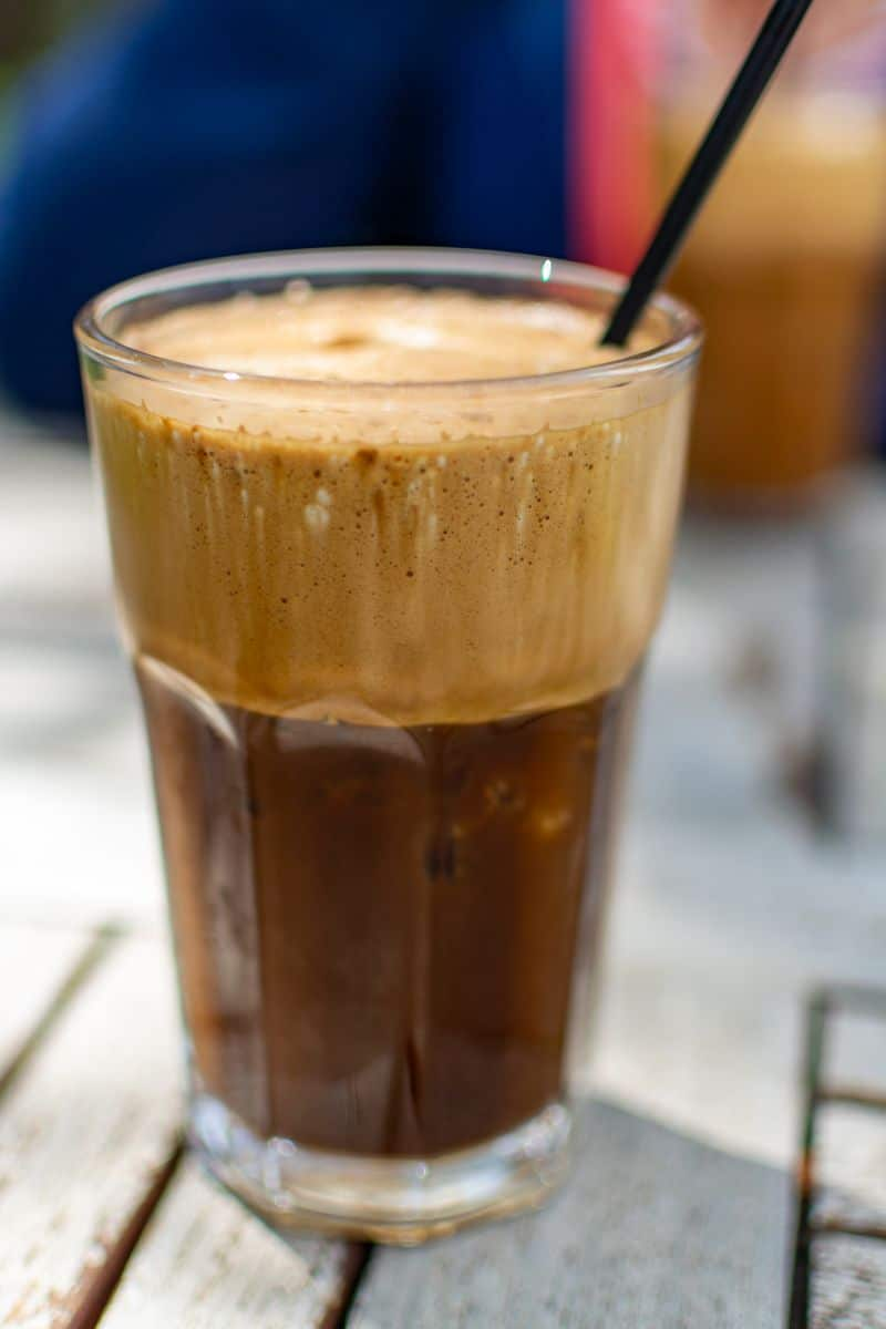 Traditional greek cold coffee Frappe with foam made from water, instant coffee and ice cubes in glass