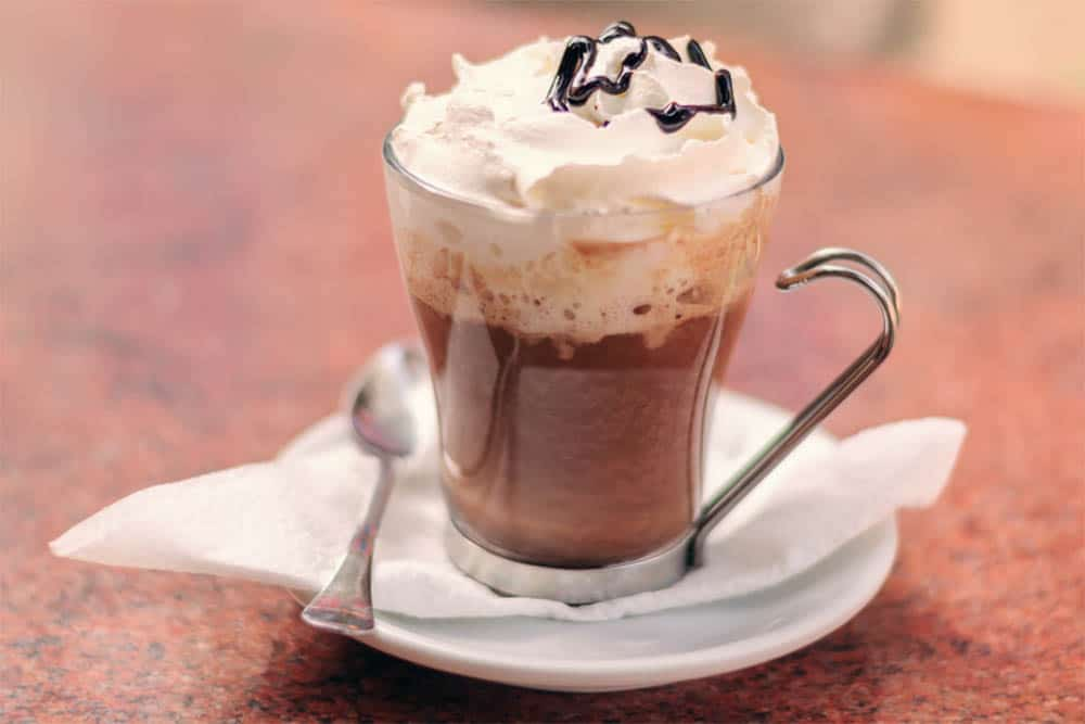 hot mocha coffee with whipped cream and chocolate syrup