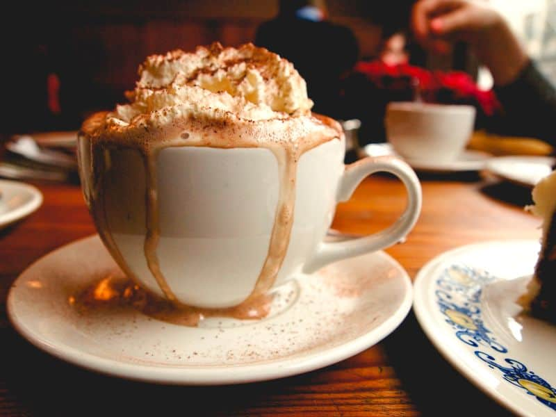 A cup of mochaccino served with delicious cream on the top