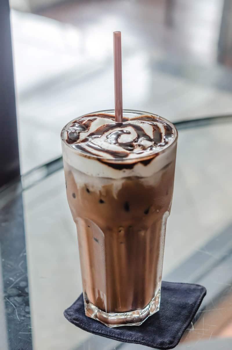 iced mocha coffee drink in tall glass.