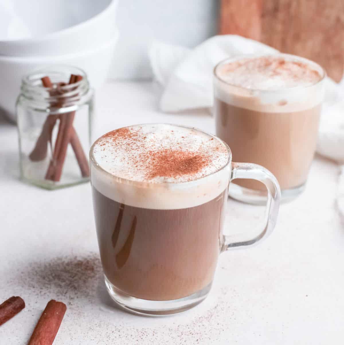 Copycat Starbucks cinnamon dolce latte in glass mug on table.